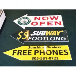 custom human directional arrow signs by spectracoloronline.com